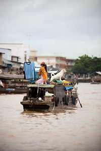 This boat is not selling shirts...boat vendors also use their poles to air dry their laundry