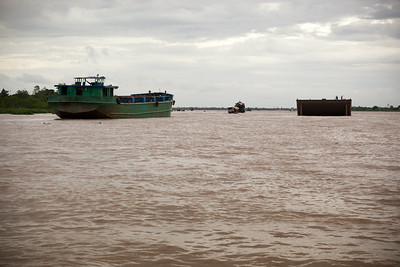 After passing near the port where we originally boarded, our boat crosses a wider section of the Mekong River