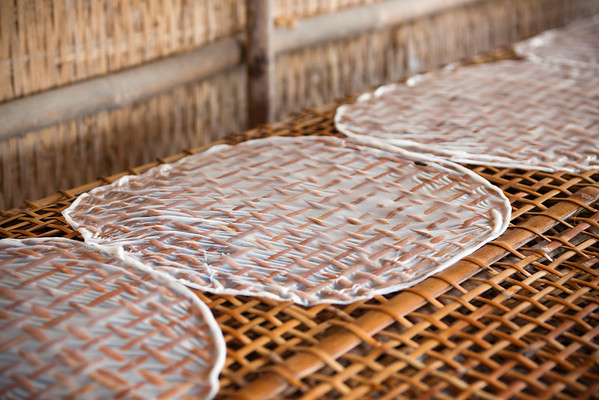 Rice paper drying on bamboo...not just for spring rolls