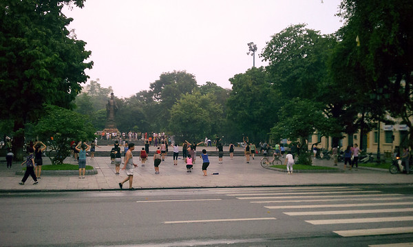 After two laps (a little over two miles) around Hoan Kiem Lake, I pause to photograph people doing some kind of aerobics. I question the use of The Godfather theme...and the quality of their workout.