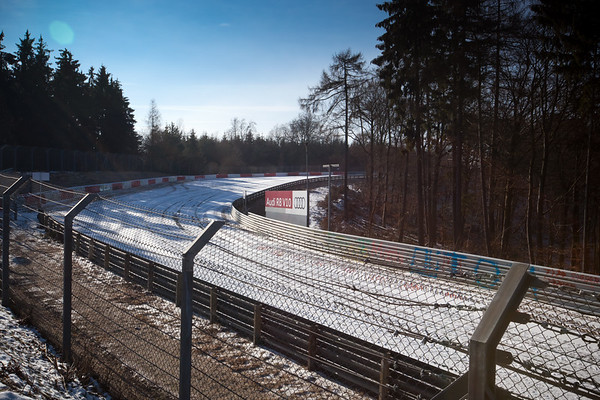 """An hour and a half after leaving Frankfurt, we catch our first glimpse of Nürburgring Nordschleife...the first time Hanno and I have actually seen """"The Green Hell"""" in person.  That said, it is not looking very green today."""