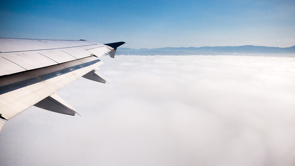 View to the north as our flight emerges from the marine layer.  As usual, I am going to have a hard time taking shots without the plane's wing in them.