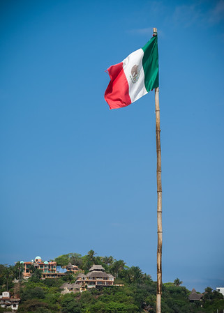 I risk switching to my long lens for a closer shot of the Mexican flag
