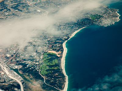 We cross back over land as Interstate 5, Torrey Pines Golf Course, and La Jolla come into view