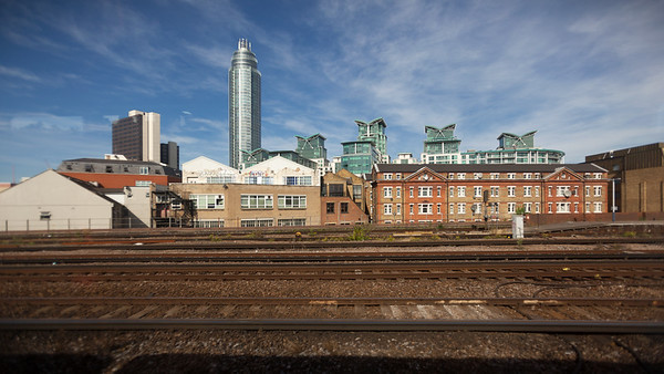 Valerie and I catch a train from Waterloo Station to Hampton Court.   Here I am looking northwest as we pass through Vauxhall Station.