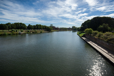 As we cross over the River Thames, we can catch a glimpse of Hampton Court Palace