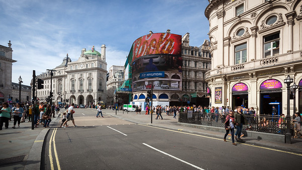 Walking east from the fountain on Coventry Street, looking back towards the famous electronic billboards