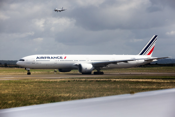 For in-flight entertainment, I am listening to the pilot communicate with the tower.  We are next in the queue after this Air France 777.