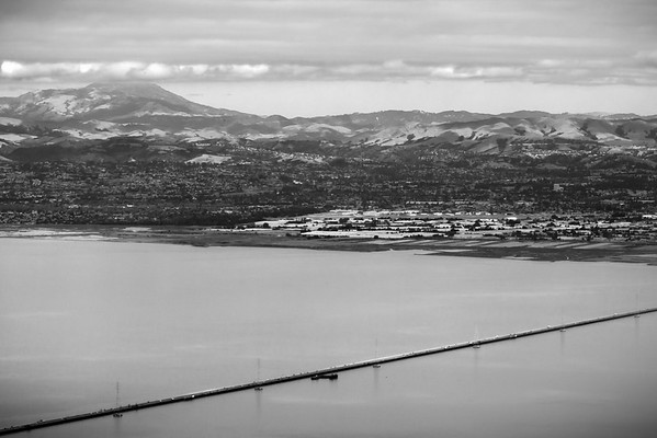 San Mateo Bridge with Mount Diablo touching the clouds in the distance