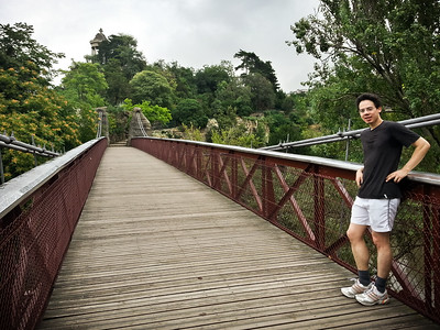 Maximilien waits to cross a 63-meter-long suspension bridge designed by Gustave Eiffel, creator of the Eiffel Tower