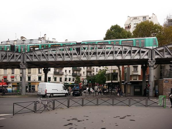 Metro travels over the intersection of Rue la Fayette and Boulevard de la Villette