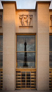 Tour Eiffel reflecting in the glass of Palais de Chaillot at sunrise