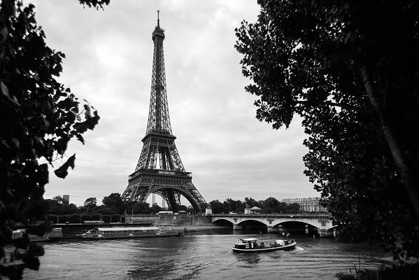 Tour Eiffel rising over La Seine in black-and-white