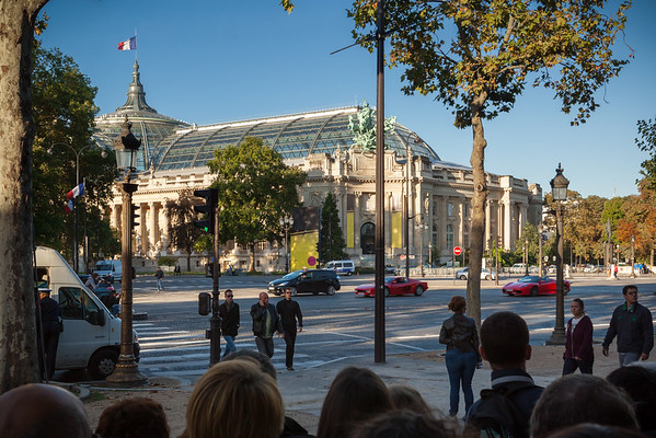 Ferraris drive down the Champs-Elysées.  We have been seeing and hearing F-cars passing by all morning, but I cannot leave the line to get good photographs of them