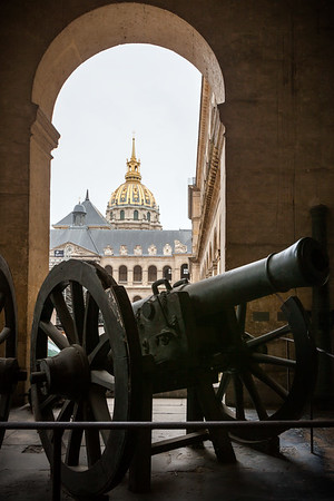 One of the cannons near the entrance (with Dôme des Invalides visible through the archway)