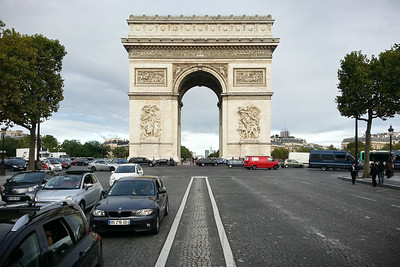 I stop for a moment in the middle of the Champs-Élysées as I make my way around the roundabout