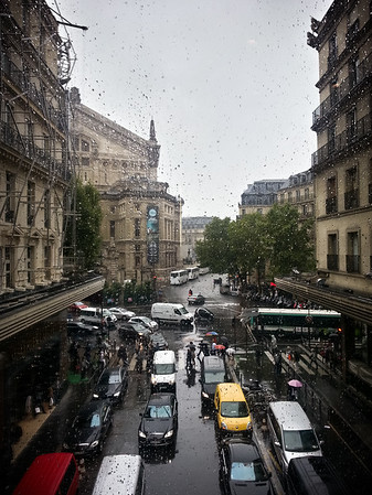 Staying dry by crossing the bridge over Rue de Mogador