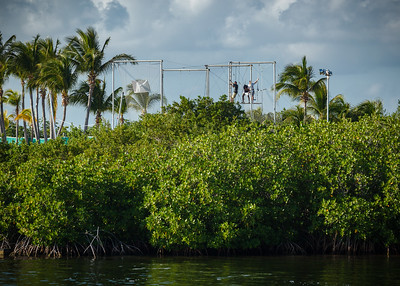 I stop by the room to grab my DSLR so I can use my long lens photograph Valerie on the trapeze.  I can actually see the trapeze across the lagoon from the Opalo building, but not from our room.