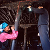 Simon Tann of Singapore, installs a light run by solar power, as a rural woman watches.<br /> Boulder has a sister city relationship with Llasa, Tibet. A delegation from Boulder and around the world visited Tibet in 1999 to help locals learn about solar energy and how they could use it.<br /> Cliff Grassmick