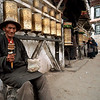 A man with a prayer wheel in Llasa.<br /> Boulder has a sister city relationship with Llasa, Tibet. A delegation from Boulder and around the world visited Tibet in 1999 to help locals learn about solar energy and how they could use it.<br /> Cliff Grassmick
