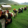 Pilgrims walk across the countryside in rural Tibet.<br /> Boulder has a sister city relationship with Llasa, Tibet. A delegation from Boulder and around the world visited Tibet in 1999 to help locals learn about solar energy and how they could use it.<br /> Cliff Grassmick