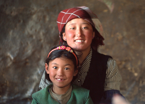 Two sisters pose for a photo in rural Tibet.<br /> Boulder has a sister city relationship with Llasa, Tibet. A delegation from Boulder and around the world visited Tibet in 1999 to help locals learn about solar energy and how they could use it.<br /> Cliff Grassmick
