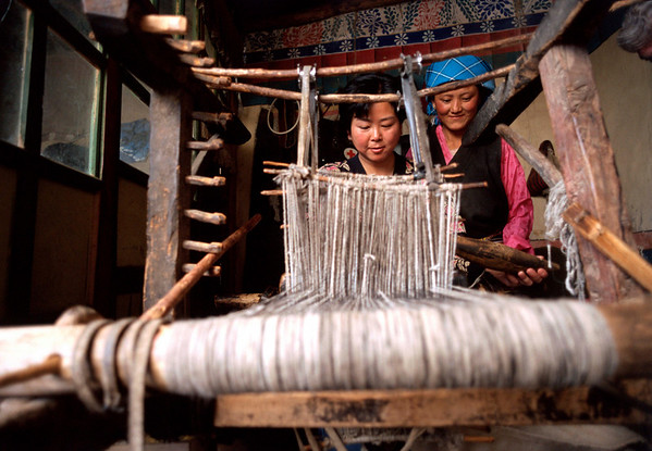 Women work on a weaving project in a rural area outside of Llasa.<br /> Boulder has a sister city relationship with Llasa, Tibet. A delegation from Boulder and around the world visited Tibet in 1999 to help locals learn about solar energy and how they could use it.<br /> Cliff Grassmick