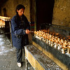 A man lights candles at a temple in Llasa.<br /> Boulder has a sister city relationship with Llasa, Tibet. A delegation from Boulder and around the world visited Tibet in 1999 to help locals learn about solar energy and how they could use it.<br /> Cliff Grassmick