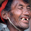 A great smile by a man in rural Tibet.<br /> Boulder has a sister city relationship with Llasa, Tibet. A delegation from Boulder and around the world visited Tibet in 1999 to help locals learn about solar energy and how they could use it.<br /> Cliff Grassmick