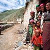 A family watches a group of visitors enter their village in rural Tibet.<br /> Boulder has a sister city relationship with Llasa, Tibet. A delegation from Boulder and around the world visited Tibet in 1999 to help locals learn about solar energy and how they could use it.<br /> Cliff Grassmick