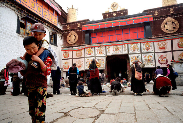 Pilgrims pray at the Jokhang Temple in Llasa.<br /> Boulder has a sister city relationship with Llasa, Tibet. A delegation from Boulder and around the world visited Tibet in 1999 to help locals learn about solar energy and how they could use it.<br /> Cliff Grassmick