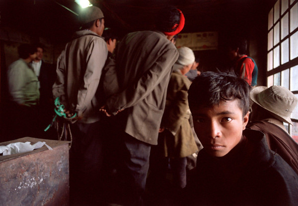A boys looks away from a curious group looking at a solar light.<br /> Boulder has a sister city relationship with Llasa, Tibet. A delegation from Boulder and around the world visited Tibet in 1999 to help locals learn about solar energy and how they could use it.<br /> Cliff Grassmick