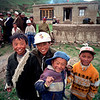 Boys have fun with this photographer in rural Tibet.<br /> Boulder has a sister city relationship with Llasa, Tibet. A delegation from Boulder and around the world visited Tibet in 1999 to help locals learn about solar energy and how they could use it.<br /> Cliff Grassmick