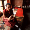 A buddhist monk waits inside the Potala Palace in Llasa.<br /> Boulder has a sister city relationship with Llasa, Tibet. A delegation from Boulder and around the world visited Tibet in 1999 to help locals learn about solar energy and how they could use it.<br /> Cliff Grassmick