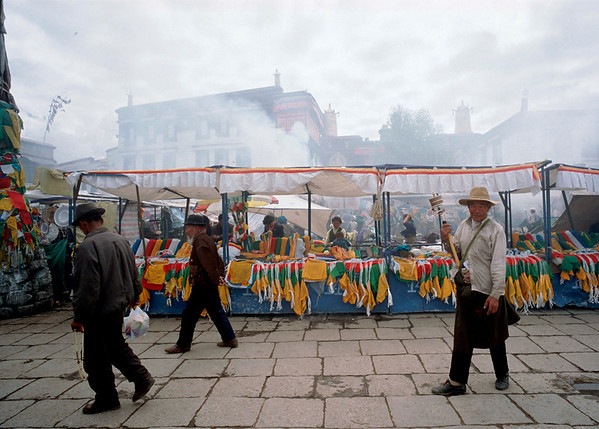 Pilgrims walk around the Jokhang Temple in Llasa.<br /> Boulder has a sister city relationship with Llasa, Tibet. A delegation from Boulder and around the world visited Tibet in 1999 to help locals learn about solar energy and how they could use it.<br /> Cliff Grassmick