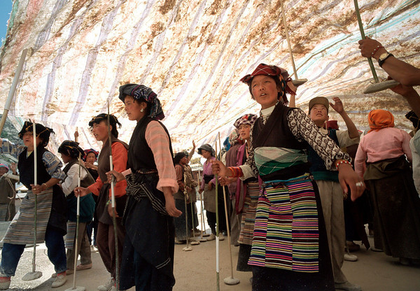 Tibetans sing and dance while applying a layer of cover on the roof of a temple in Llasa.<br /> Boulder has a sister city relationship with Llasa, Tibet. A delegation from Boulder and around the world visited Tibet in 1999 to help locals learn about solar energy and how they could use it.<br /> Cliff Grassmick