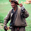 An elderly man spins some yak wool in rural Tibet.<br /> Boulder has a sister city relationship with Llasa, Tibet. A delegation from Boulder and around the world visited Tibet in 1999 to help locals learn about solar energy and how they could use it.<br /> Cliff Grassmick