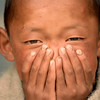 A Tibetan boy watches this photographer.<br /> Boulder has a sister city relationship with Llasa, Tibet. A delegation from Boulder and around the world visited Tibet in 1999 to help locals learn about solar energy and how they could use it.<br /> Cliff Grassmick