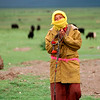 A herding woman greets guests to her yak pasture.<br /> Boulder has a sister city relationship with Llasa, Tibet. A delegation from Boulder and around the world visited Tibet in 1999 to help locals learn about solar energy and how they could use it.<br /> Cliff Grassmick
