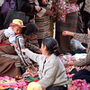 A boy gets a treat at the marketplace in Llasa.<br /> Boulder has a sister city relationship with Llasa, Tibet. A delegation from Boulder and around the world visited Tibet in 1999 to help locals learn about solar energy and how they could use it.<br /> Cliff Grassmick