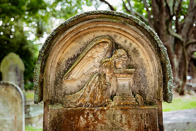 Angel carving on a gravestone in Symonds Street Cemetery, Auckland, NZ.