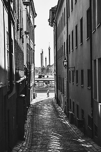 Gröna Lund, amusement park, seen in the distance through a Gamla Stan alley in Stockholm.