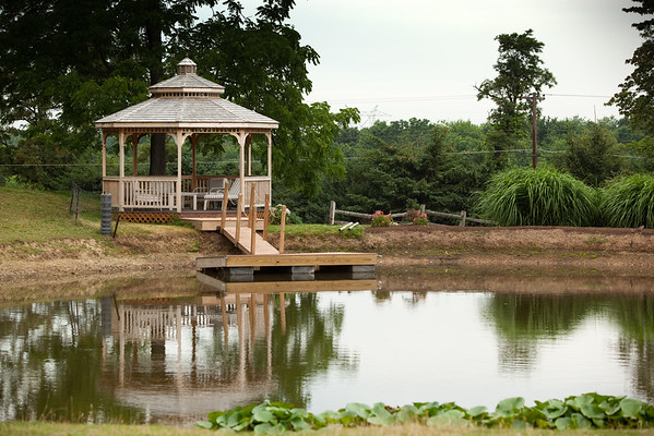 The gazebo reflects upon the pond