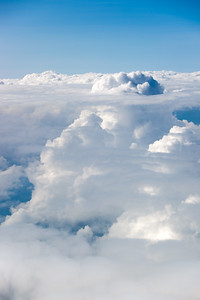 Thunderheads poke through the upper cloud layer