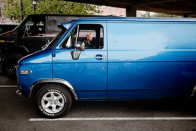 A man passes between two vans, part of the Van Haven gathering in Georgetown.
