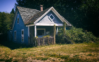 Abandoned home seen next to a gas station on the road to Port Angeles, WA.