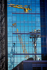 Reflection of Space Needle and Cranes