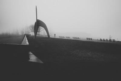 A woman jogs past The Eagle, a steel sculpture by Alexander Calder, 1971, Olympic Sculpture Park, Olympic Sculpture Park.