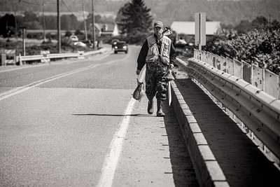 A fisherman heads home with his salmon catch, caught out of the Samish River near Edison, Washington.