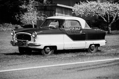 Little old car for sale, painted in B&W – seen across the street from Chuckanut Manor Seafood & Grill.